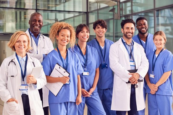 portrait-of-smiling-medical-team-standing-in-moder-LYUAHD4.jpg